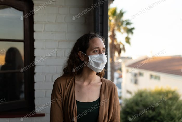Caucasian woman spending time at home self isolating and social distancing in quarantine lockdown du