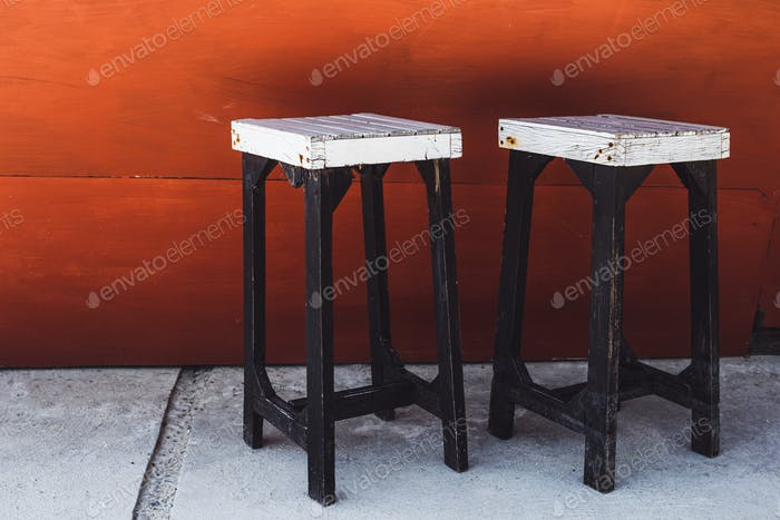 Vintage white bar stools on a red background