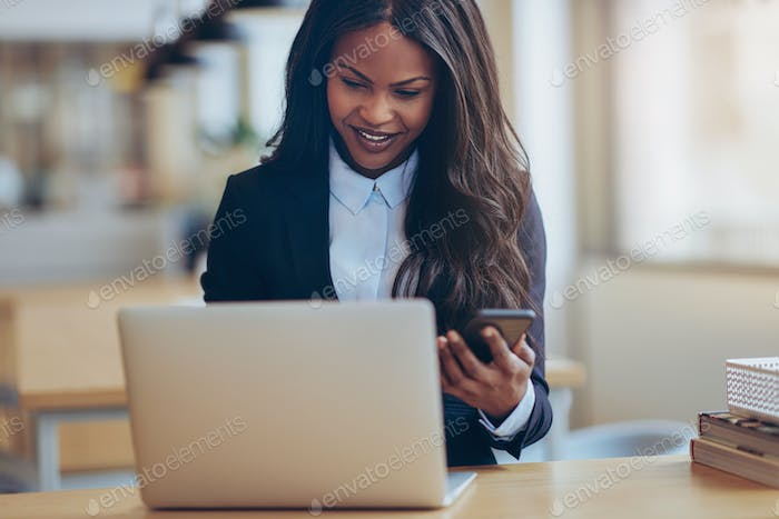 Smiling African American businesswoman busy working in an office