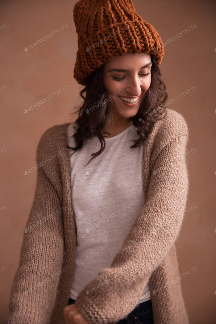 Happy woman in knitted sweater and hat