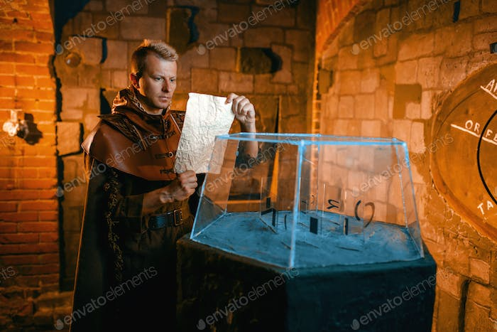 Traveler solving ancient map in the temple dungeon