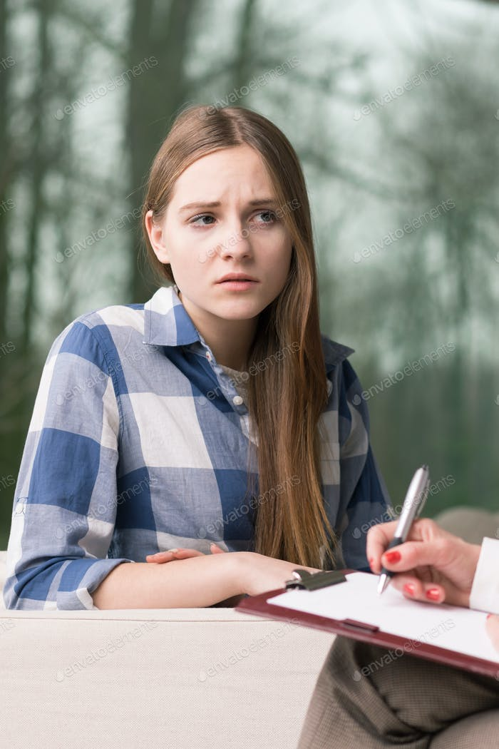 Worried teenage girl during psychotherapy
