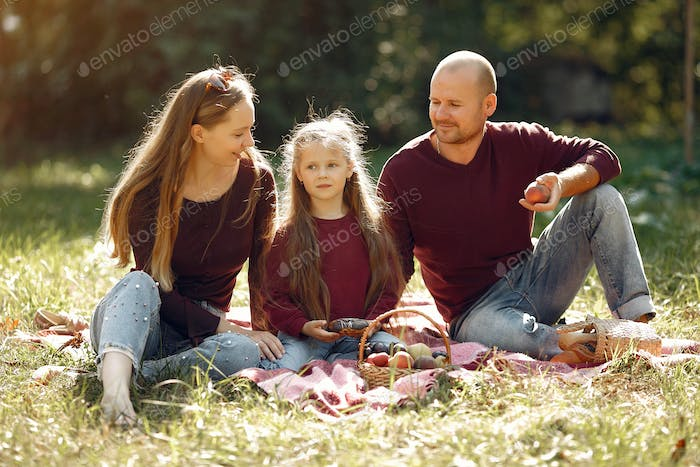 Family with cute kids in a autumn park