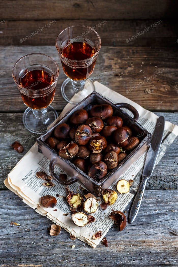 Roasted chestnuts in an old box. Selective focus.