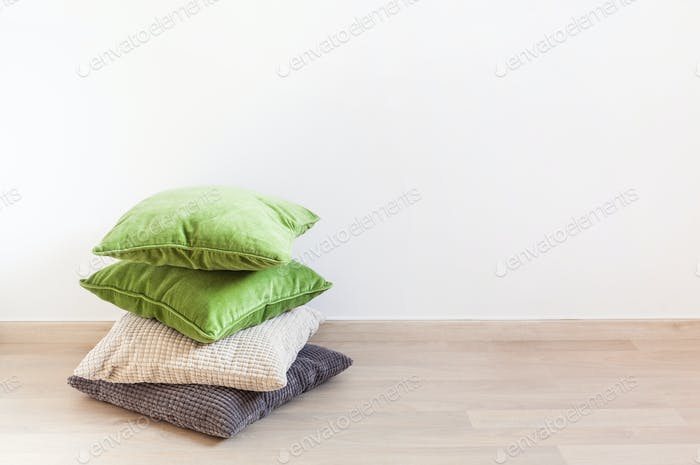 gray and green cushions, cozy home