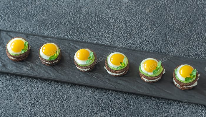 Canape with fried quail eggs