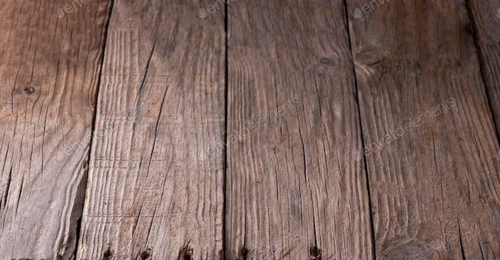 Old rustic wooden background with holes from the nails