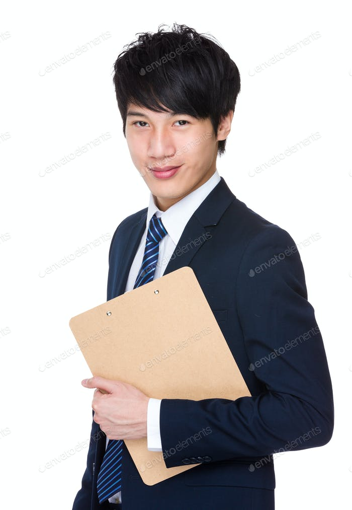 Young attractive businessman holding a folder