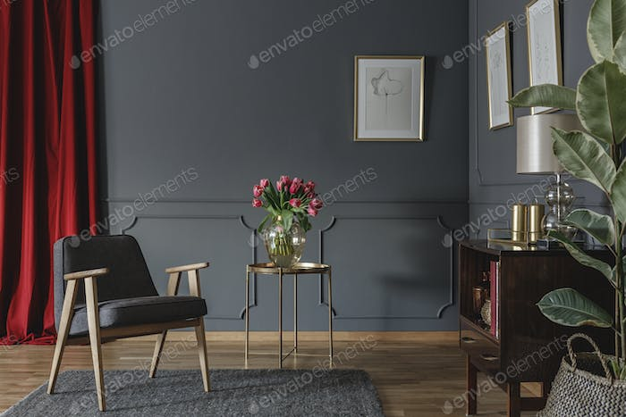 Elegant living room interior with fresh pink tulips on gold tabl