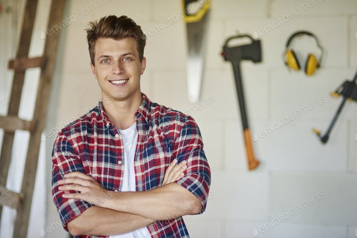 Proud and confident carpenter is posing