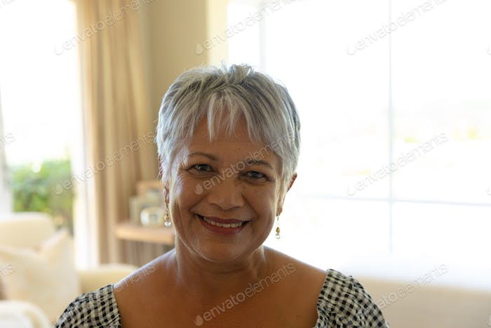 Senior mixed race woman smiling and looking at camera