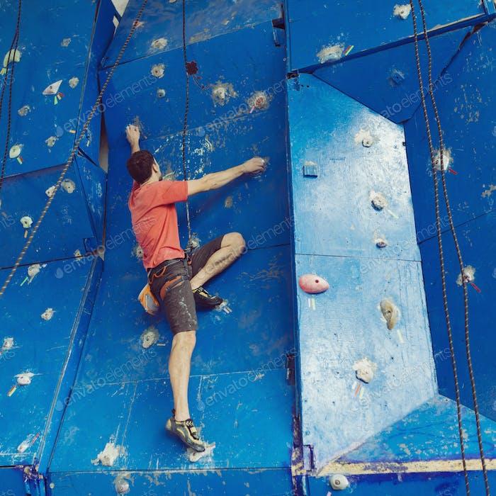 Fit man rock climbing