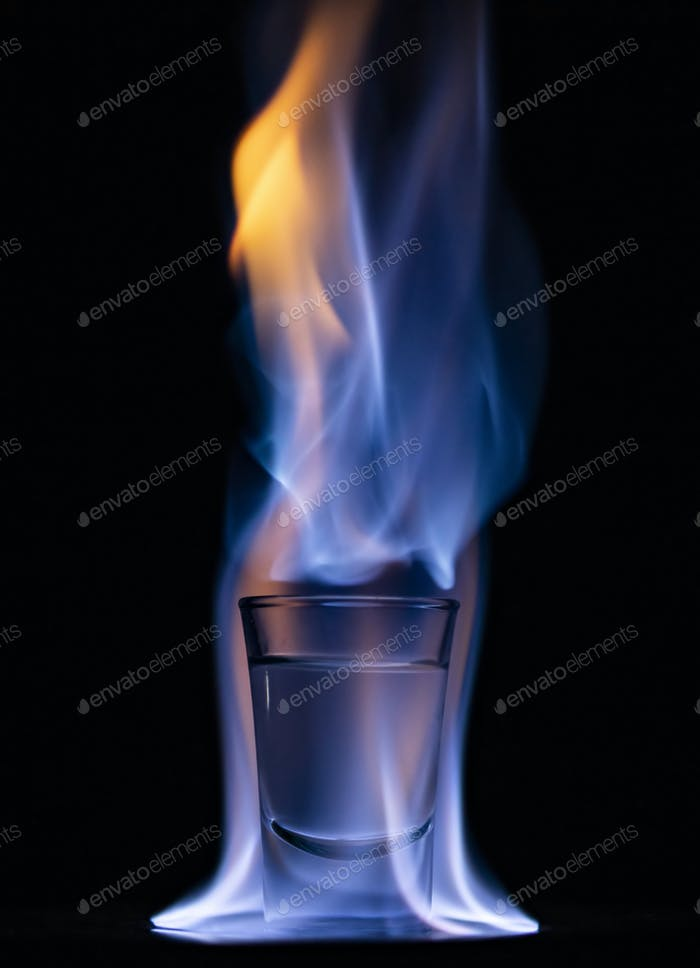 Burning drink in shot glass