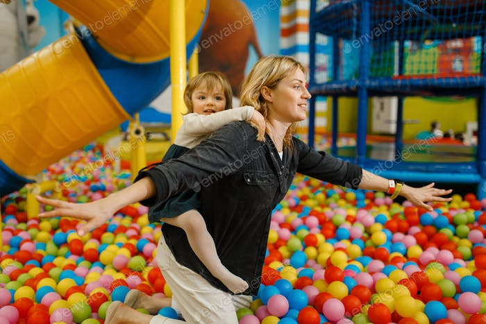 Children plays with mother in entertainment center