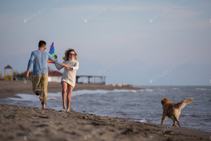 happy couple enjoying time together at beach