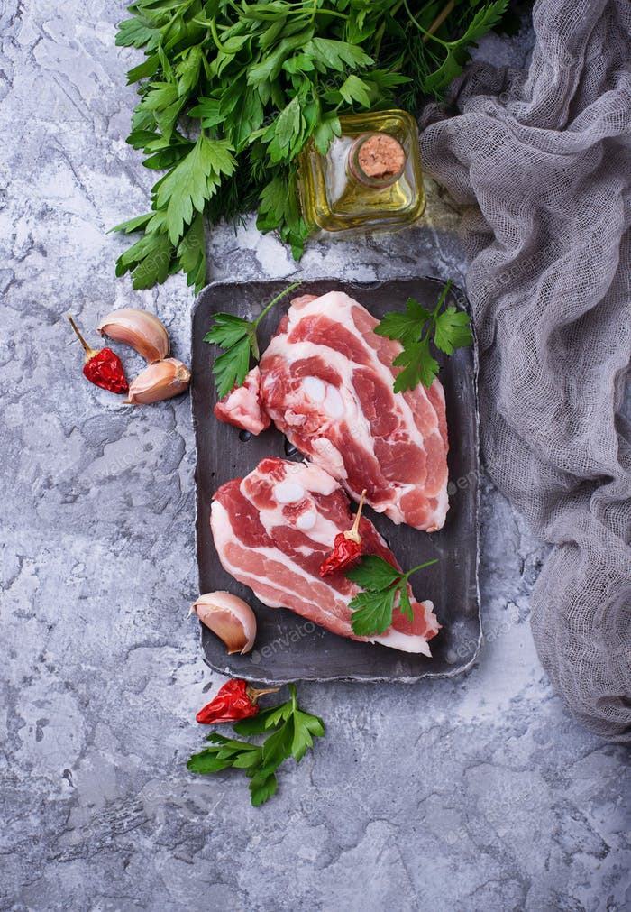Raw pork meat and ingredients for cooking