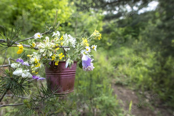 Bucket with wildflowers