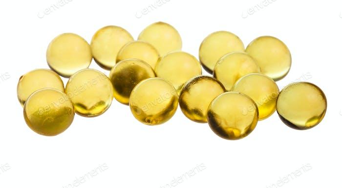 viele Kapseln mit Öl Nahaufnahme isoliert