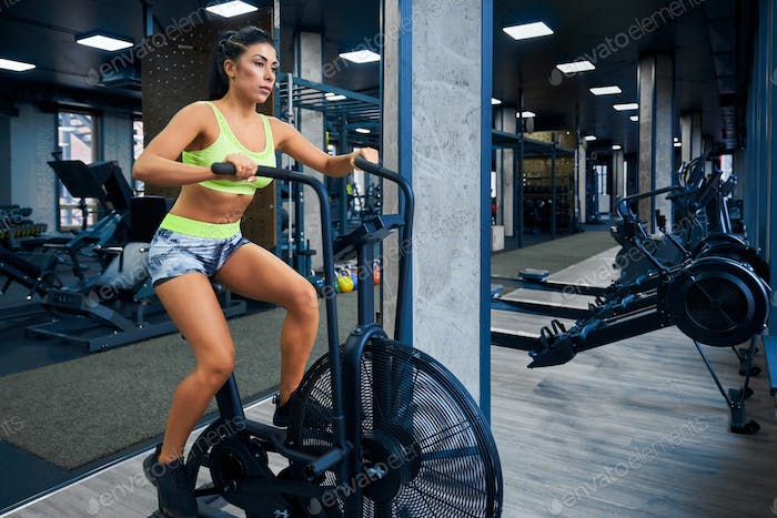 Fitness woman doing cardio in gym