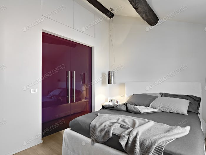 Interiors of the Modern Bedroom in the Attic Room