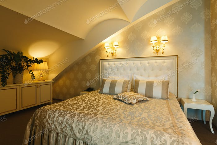 Interior of double bed hotel bedroom