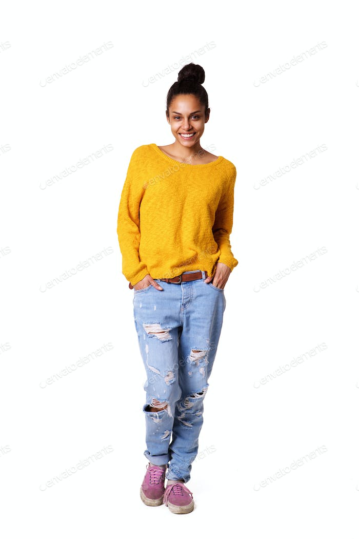 Stylish young african woman standing on white