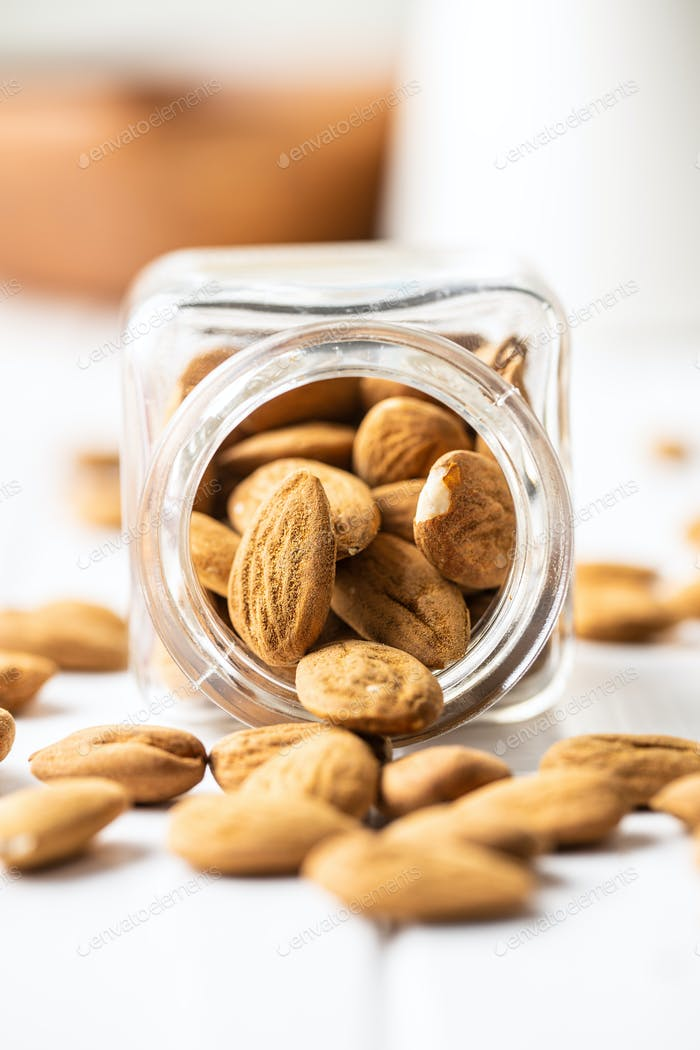 Dried almonds nuts in jar.
