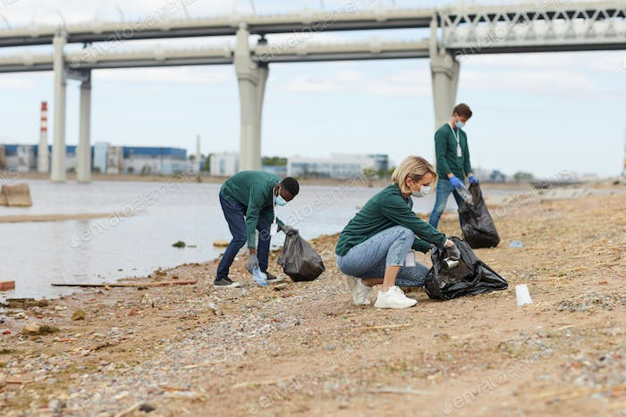 Volunteers cleaning the river