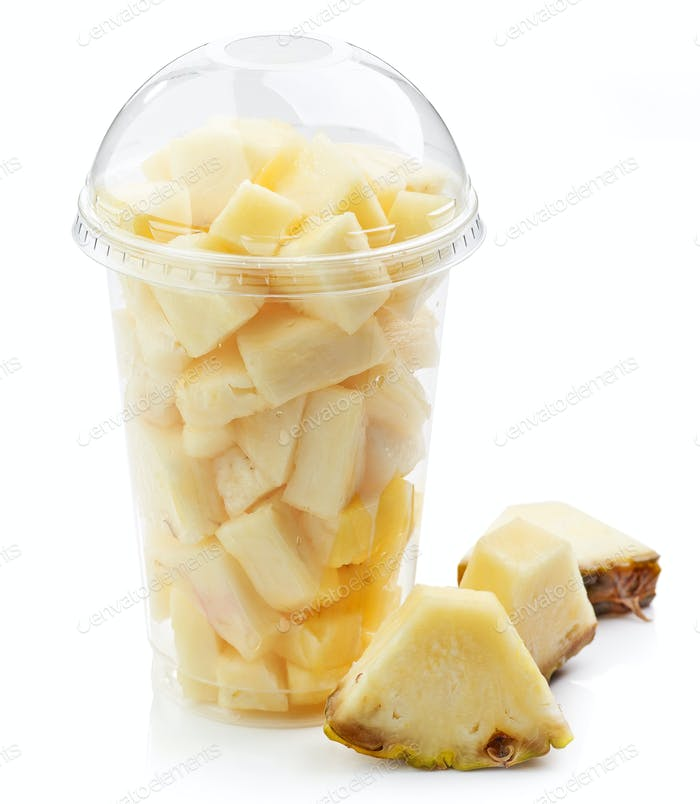 Plastic cup of pineapple pieces