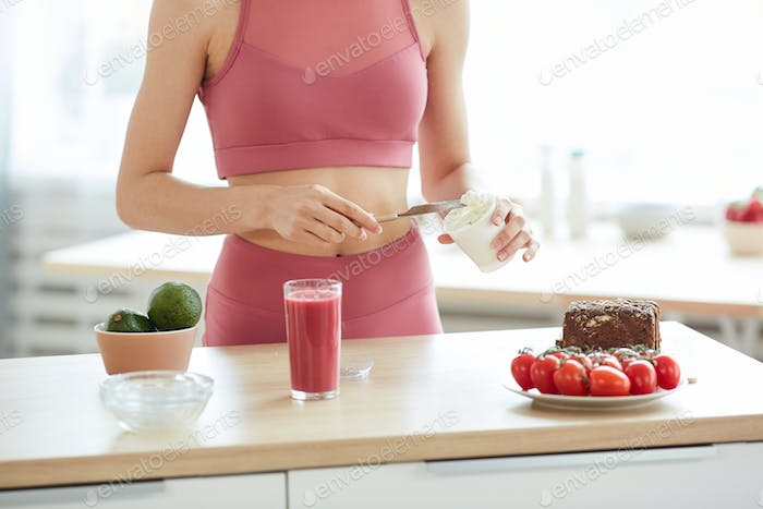 Unrecognizable Sportive Woman Cooking Healthy Lunch
