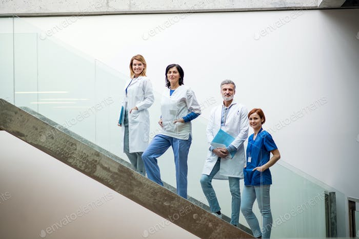 Group of doctors standing on stairs on medical conference