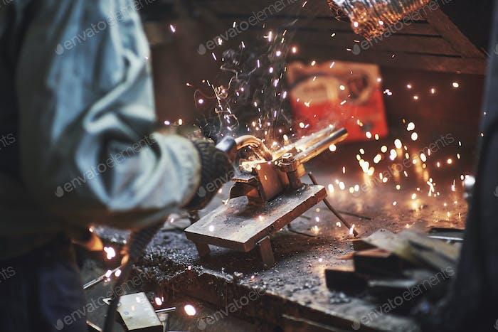 Industrial factory weld worker. Welding or welder master weld the steel