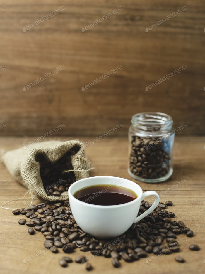 black coffee and coffee bag with wood background