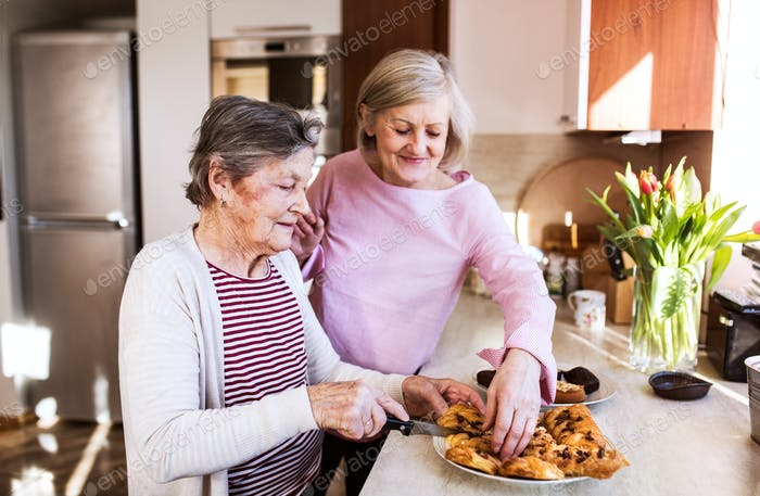 Senior women preparing food in the kitchen.