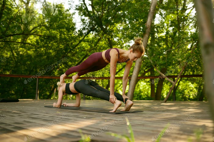 Two women doing balance exercise, yoga training