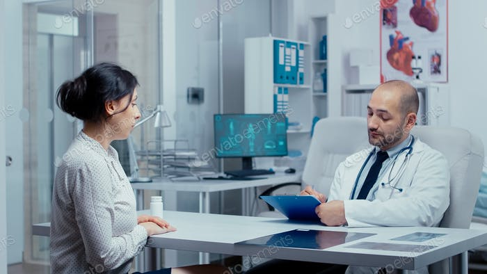Doctor questioning young female patient
