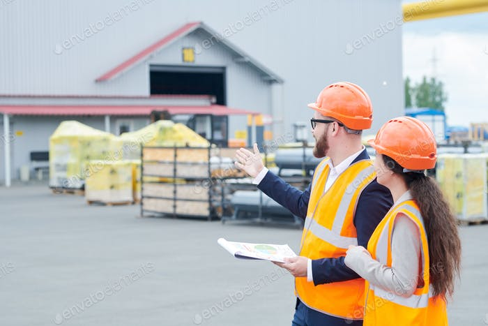 Factory Foreman Giving Instruction to Worker
