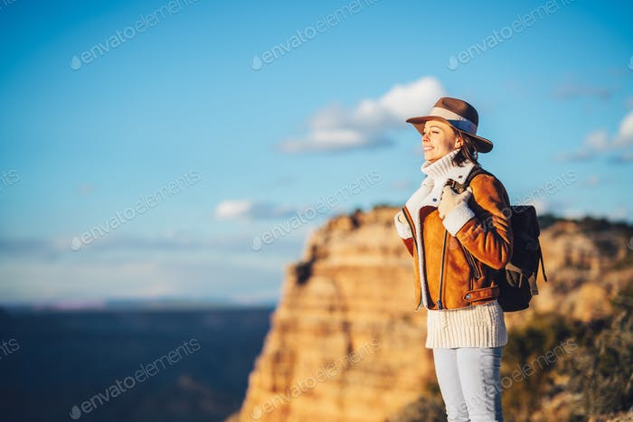 Young hiker with a backpack outdoors