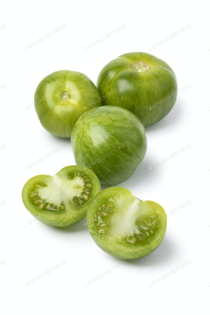 Green striped tomatoes and halved ones