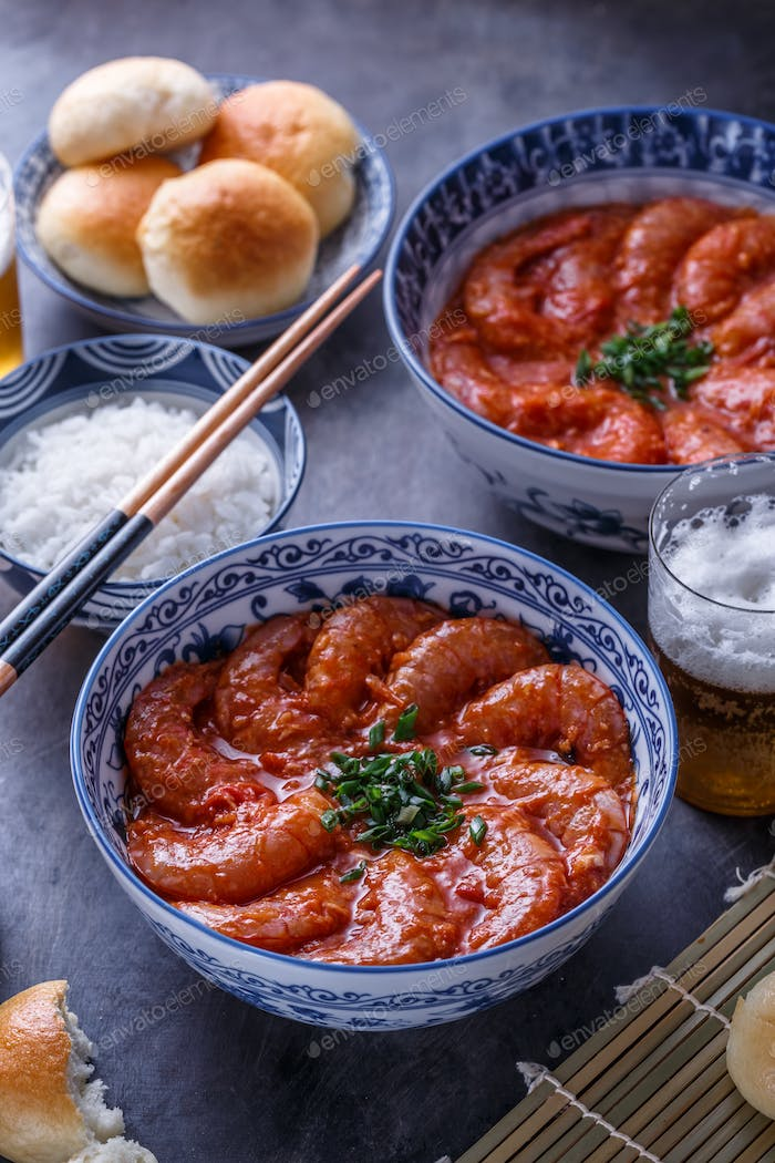 Prawns in spicy tomato sauce with rice, close view, asian cuisine