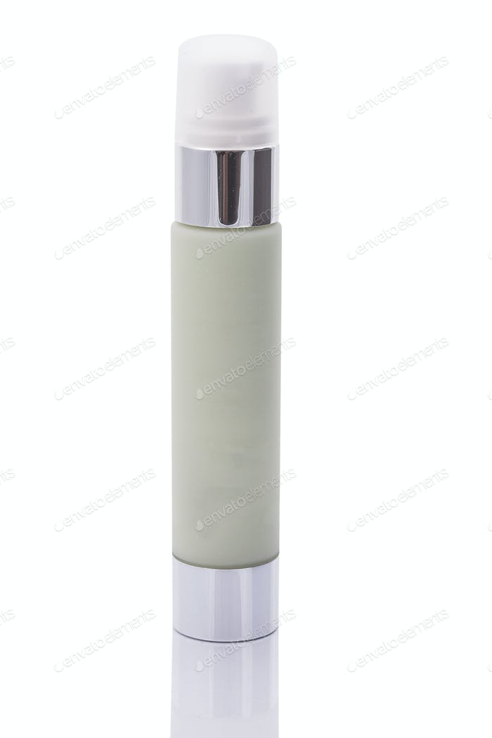 Green cosmetic bottle isolated over white background
