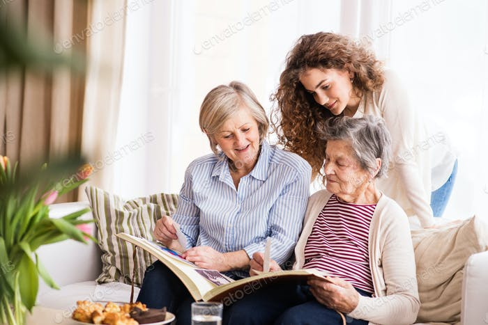A teenage girl, mother and grandmother at home.