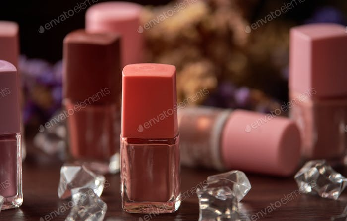 The bottles of nail polish on the table