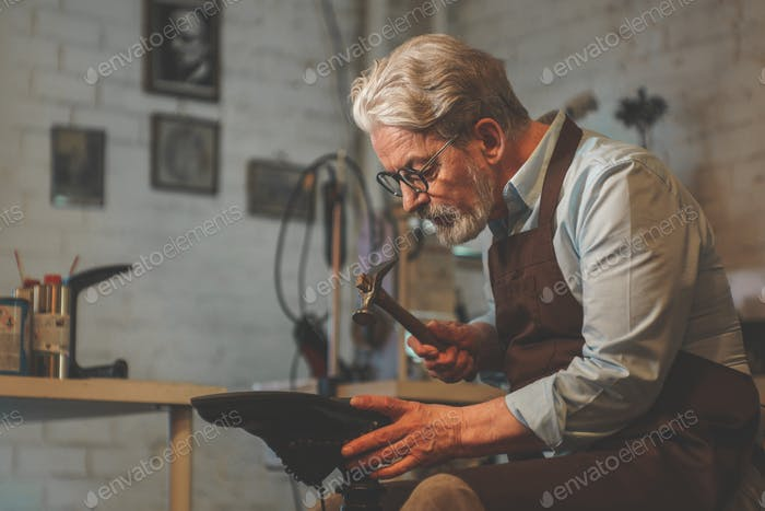 An elderly man in a workshop