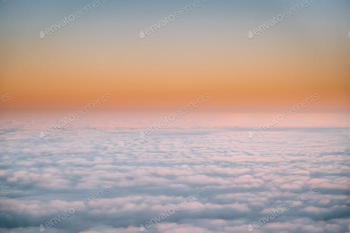 Beautiful Aerial View Of Sunny Clear Sky Over White Fluffy Cloud