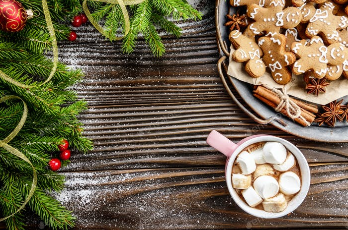 Flat lay Christmas background of pink mug with hot chocolate and