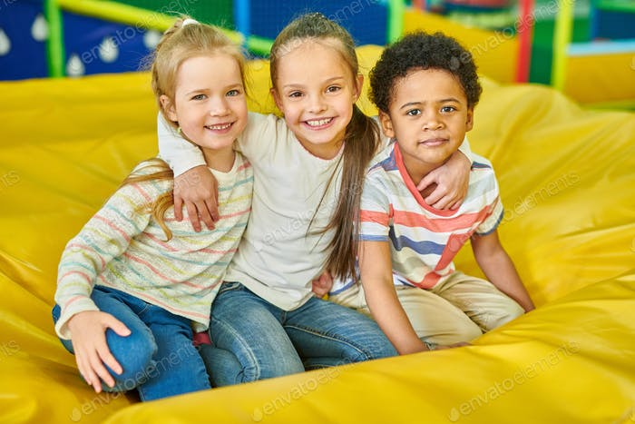 Portrait of Kids in Play Center