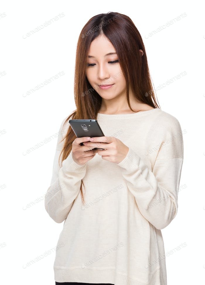 Asian young woman use of the mobile phone