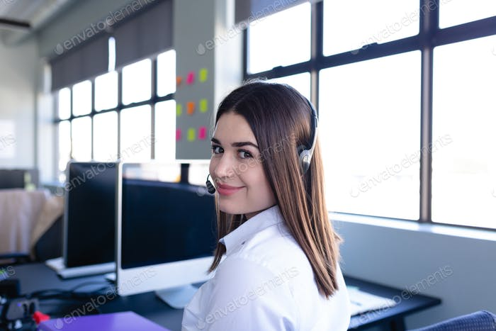 Caucasian woman working with headphone set