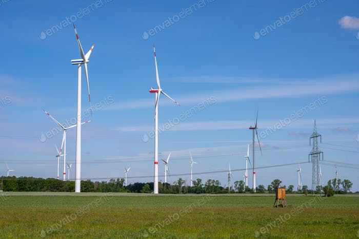 Modern windmills and a power line